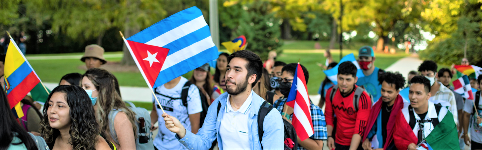 CLS students with flags from Latin American countries during the March Up Bascom